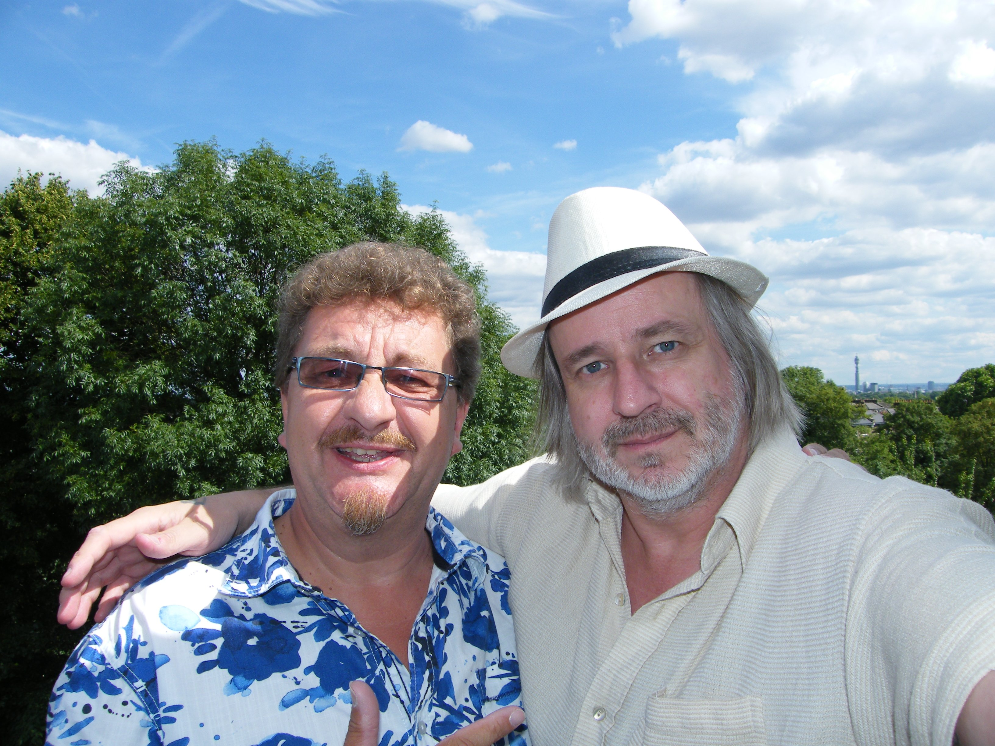 Down from the roof, but on his balcony! PETE LOCKETT (R) with Bob from the Global Drum Network (Episode 7)